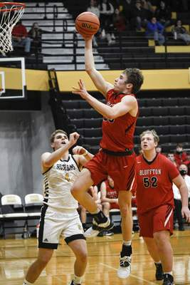 Mike Moore   The Journal Gazette Bluffton Senior Hayden Nern scores a layup in the third period against South Adams on Saturday.