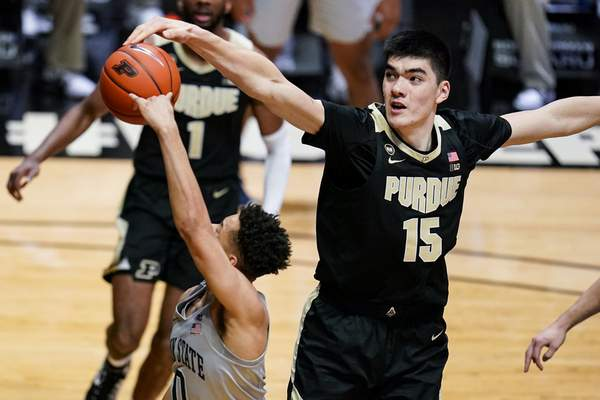 Purdue center Zach Edey (15) blocks the shot of Penn State guard Myreon Jones (0) during the first half of an NCAA college basketball game in West Lafayette, Ind., Sunday, Jan. 17, 2021. (AP Photo/Michael Conroy)