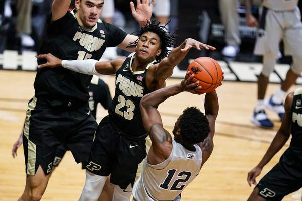Purdue guard Jaden Ivey (23) goes up to block the shot of Penn State guard Izaiah Brockington (12) during the first half of an NCAA college basketball game in West Lafayette, Ind., Sunday, Jan. 17, 2021. (AP Photo/Michael Conroy)