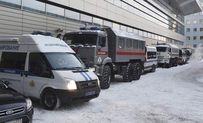 Russian Rosguardia (National Guard) and police buses stand prior to Alexei Navalny's arrival, at the Vnukovo airport, outside Moscow, Russia, Sunday, Jan. 17, 2021. (AP Photo/Dmitry Serebryakov)