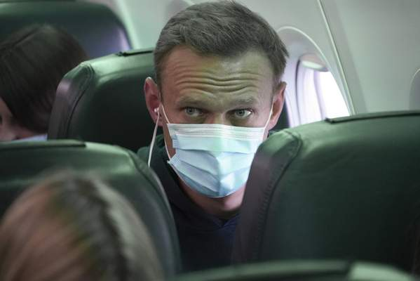 Alexei Navalny sits on the plane prior to a flight to Moscow, at the Airport Berlin Brandenburg (BER) in Schoenefeld, near Berlin, Germany, Sunday, Jan. 17, 2021. (AP Photo/Mstyslav Chernov)