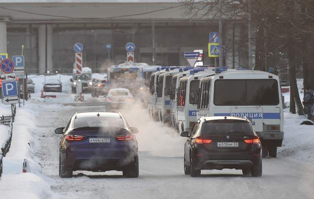 Police buses parked, prior to Alexei Navalny's arrival, at the Vnukovo airport, outside Moscow, Russia, Sunday, Jan. 17, 2021. (AP Photo/Dmitry Serebryakov)