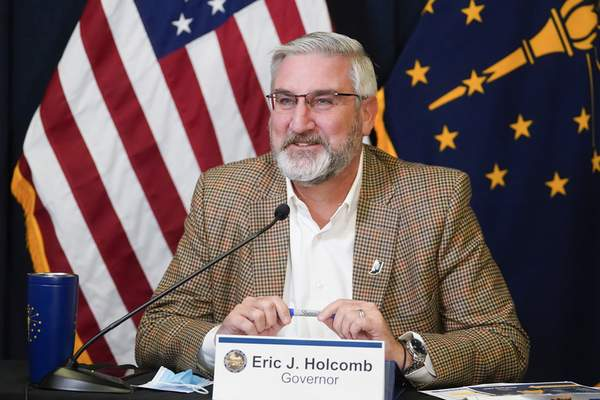 Indiana Gov. Eric Holcomb speaks during a media availability from the Statehouse, Tuesday, Jan. 5, 2021, in Indianapolis. (AP Photo/Darron Cummings)