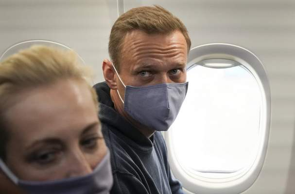 Alexei Navalny and his wife, Yulia sit in the plane prior to their flight to Moscow in the Airport Berlin Brandenburg (BER) in Schoenefeld, near Berlin, Germany, Sunday, Jan. 17, 2021. (AP Photo/Mstyslav Chernov)