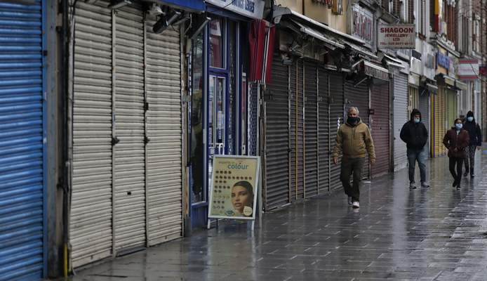 People walk past closed stores in London, Saturday, Jan. 16, 2021, during England's third national lockdown since the coronavirus outbreak began. (AP Photo/Frank Augstein)