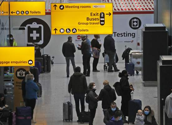 Travellers wait at the Covid-19 testing facility at Heathrow Airport in London, Sunday, Jan. 17, 2021. (AP Photo/Frank Augstein)