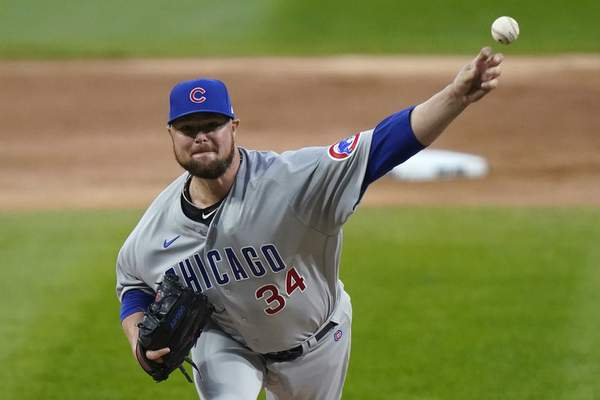 FILE - In this Sept. 26, 2020, file photo, Chicago Cubs starting pitcher Jon Lester throws to a Chicago White Sox batter during the first inning of a baseball game in Chicago. A person with knowledge of the deal has confirmed to The Associated Press that left-hander Lester and the Washington Nationals have an agreement in principle in place for a one-year contract. The deal is pending the successful completion of a physical exam. (AP Photo/Nam Y. Huh, File)