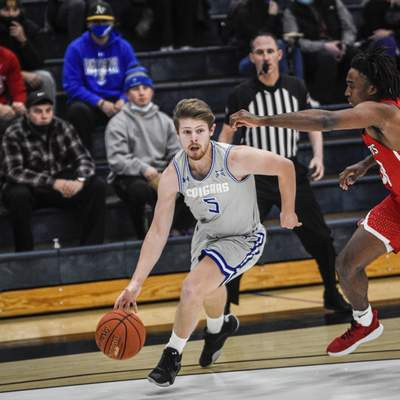 Mike Moore | The Journal Gazette Saint Francis guard Dan McKeeman attacks the lane on Monday in the first half against Indiana Wesleyan University at the Hutzell Athletic Center.