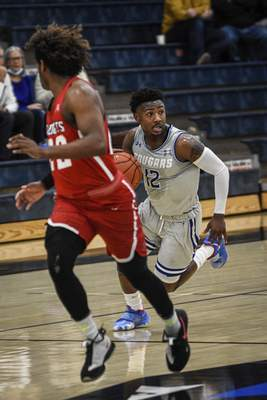 Mike Moore | The Journal Gazette Saint Francis guard Antwaan Cushingberry on Monday in the first half against Indiana Wesleyan University at the Hutzell Athletic Center.