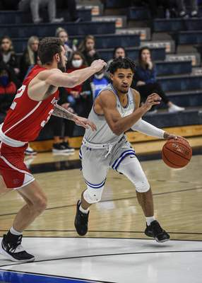 Mike Moore | The Journal Gazette Saint Francis guard Jalan Mull attacks the lane on Monday in the first half against Indiana Wesleyan University at the Hutzell Athletic Center.