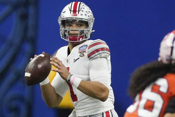 FILE - In this Friday, Jan. 1, 2021, file photo, Ohio State quarterback Justin Fields passes against Clemson during the second half of the Sugar Bowl NCAA college football game in New Orleans. Fields is foregoing his senior season to enter the NFL draft, in an announcement posted on social media, Monday, Jan. 18, 2021. Fields, expected to be a first-round draft choice, went 20-2 as a two-year starter for the Buckeyes. (AP Photo/John Bazemore, File)