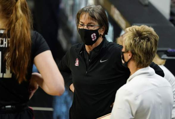 Stanford head coach Tara VanDerveer confers with players in a timeout late in overtime of an NCAA college basketball game against Colorado, Sunday, Jan. 17, 2021, in Boulder, Colo. (AP Photo/David Zalubowski)