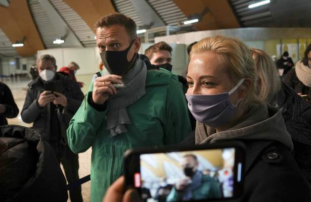 Alexei Navalny and his wife Yuliastand in line at the passport control after arriving at Sheremetyevo airport, outside Moscow, Russia, Sunday, Jan. 17, 2021. (AP Photo/Mstyslav Chernov)