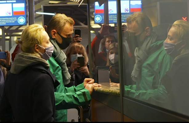 In this grab taken from video, Alexei Navalny and his wife Yulia stand at the passport control before Navalny was detained by police after arriving at Sheremetyevo airport, outside Moscow, Russia, Sunday, Jan. 17, 2021. (AP)