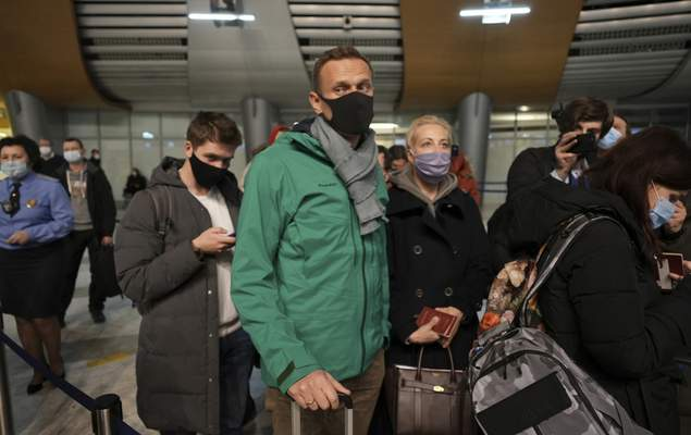 Alexei Navalny and his wife Yuliastand in line at the passport control after arriving at Sheremetyevo airport, outside Moscow, Russia, Sunday, Jan. 17, 2021. . (AP Photo/Mstyslav Chernov)