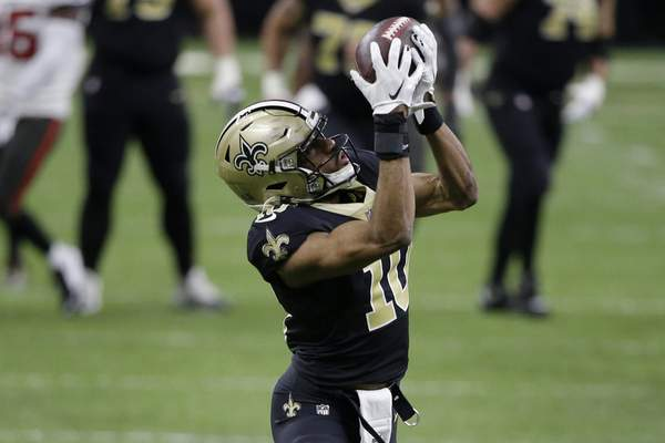 New Orleans Saints wide receiver Tre'Quan Smith (10) makes a touchdown catch against the Tampa Bay Buccaneers during the first half of an NFL divisional round playoff football game, Sunday, Jan. 17, 2021, in New Orleans. (AP Photo/Butch Dill)