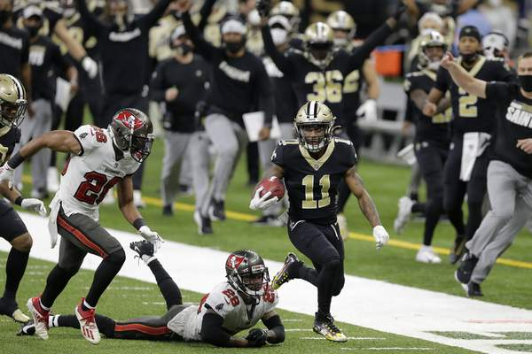New Orleans Saints' Deonte Harris (11) returns a punt against the Tampa Bay Buccaneers during the first half of an NFL divisional round playoff football game, Sunday, Jan. 17, 2021, in New Orleans. (AP Photo/Brett Duke)