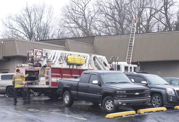 Michelle Davies | The Journal Gazette Firefighters respond to a call Monday morning at Tom Steele Tire on North Clinton Street. Firefighters found smoke in a tire storage area and quickly extinguished the fire.