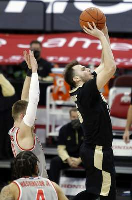 Purdue guard Sasha Stefanovic, right, goes up for a shot over Ohio State forward Justin Ahrens during the second half of an NCAA college basketball game in Columbus, Ohio, Tuesday, Jan. 19, 2021. (AP Photo/Paul Vernon)