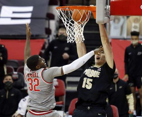 Purdue center Zach Edey, right, dunks the ball against Ohio State forward E.J. Liddell during the second half of an NCAA college basketball game in Columbus, Ohio, Tuesday, Jan. 19, 2021. (AP Photo/Paul Vernon)