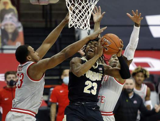 Associated Press Purdue guard Jaden Ivey, center, goes up for a shot between Ohio State forward Zed Key, left, and guard Eugene Brown on Tuesday in Columbus, Ohio.