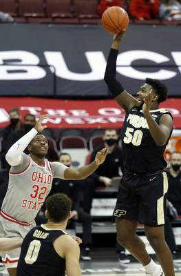 Associated Press  Purdue forward Trevion Williams, right, goes up for a shot against Ohio State forward E.J. Liddell during the first half of an NCAA college basketball game in Columbus, Ohio, Tuesday, Jan. 19, 2021. (AP Photo/Paul Vernon)