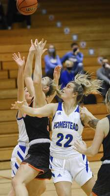 Mike Moore | The Journal Gazette Homestead sophomore Allison Stephens looks for the ball in the second period against Warsaw at Homestead High School on Tuesday.