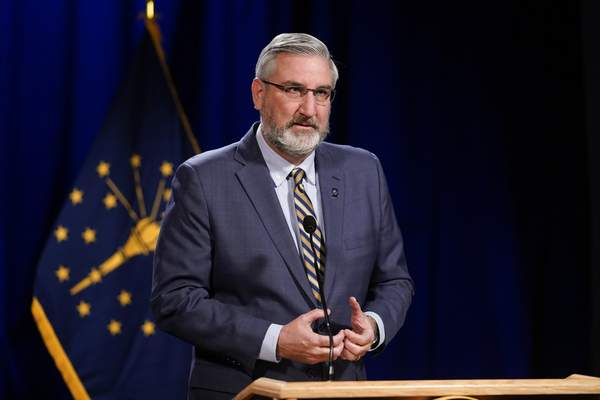 Indiana Gov. Eric Holcomb delivers his State of the State address virtually, Tuesday, Jan. 19, 2021, in Indianapolis. (AP Photo/Darron Cummings)