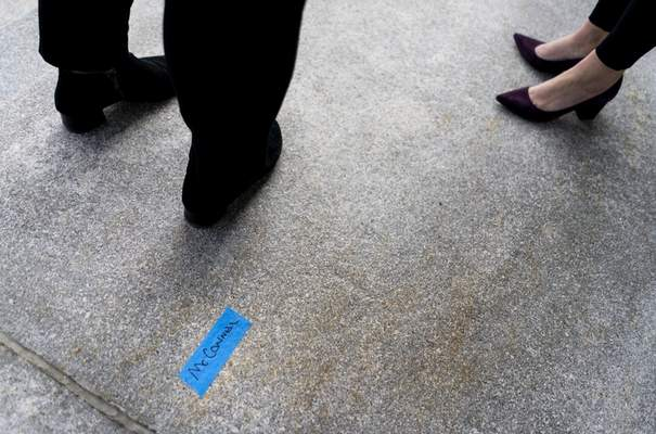 On the East side of the U.S. Capitol, a piece of tape marks the name McConnell as people participate in a rehearsal for the 59th inaugural ceremony for President-elect Joe Biden and Vice President-elect Kamala Harris on Monday, Jan. 18, 2021, in Washington. (Melina Mara/The Washington Post via AP, Pool)