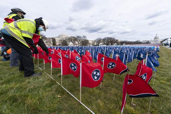 State flags including the Tennessee state flag, in front, are placed on the National Mall ahead of the inauguration of President-elect Joe Biden and Vice President-elect Kamala Harris, Monday, Jan. 18, 2021, in Washington. (AP Photo/Alex Brandon)