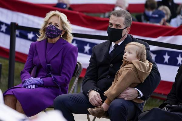 President-elect Joe Biden's wife Jill Biden sits with Hunter Biden and his child during an event at the Major Joseph R. Beau Biden III National Guard/Reserve Center, Tuesday, Jan. 19, 2021, in New Castle, Del. (AP Photo/Evan Vucci)