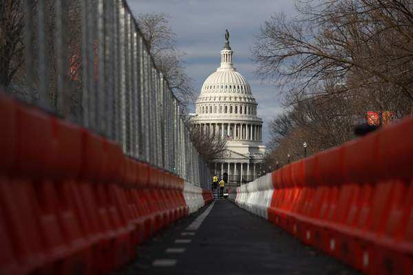 Steel fencing and barb wire surround the Capitol building as security is heightened ahead of President-elect Joe Biden's inauguration ceremony, Tuesday, Jan.19, 2021, in Washington. (AP Photo/Rebecca Blackwell)