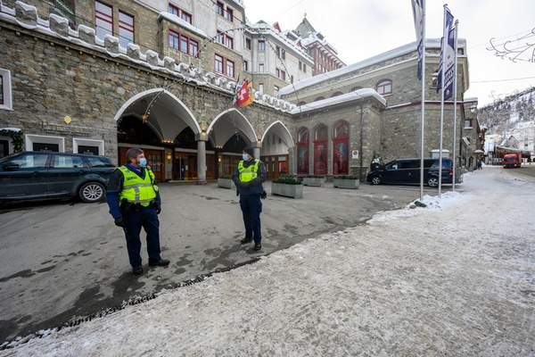 The Hotel Badrutt's Palace with police guards in front is pictured in St. Moritz, Switzerland, Monday, Jan. 18, 2021. (Giancarlo Cattaneo/Keystone via AP)