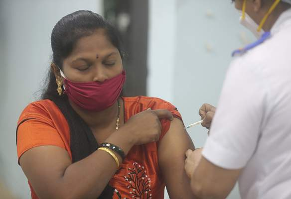 A health worker receives a COVID-19 vaccine at a government Hospital in Mumbai, India, Tuesday, Jan 19, 2021. (AP Photo/Rafiq Maqbool)
