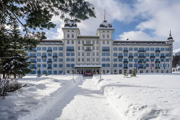 The Hotel Kempinski with police guards in front is pictured in St. Moritz, Switzerland, Monday, Jan. 18, 2021. (Giancarlo Cattaneo/Keystone via AP)