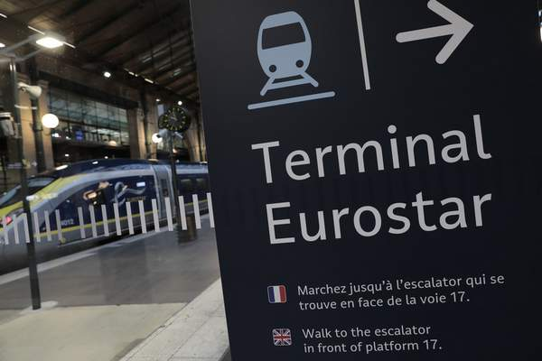 FILE - In this Dec.21, 2020 file photo, an information board is displayed at Gare du Nord train station in Paris. (AP Photo/Lewis Joly, File)