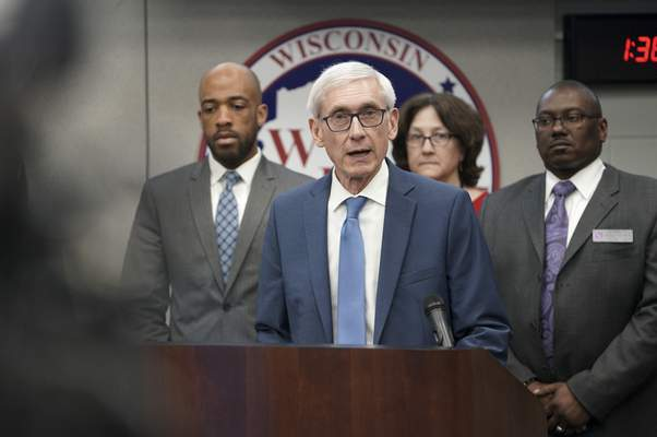 FILE - In this March 12, 2020 file photo, Gov. Tony Evers declares a public health emergency in Madison, Wis. (Steve Apps/Wisconsin State Journal via AP, File)
