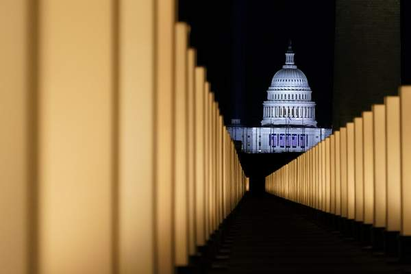 Associated Press Lights surround the Lincoln Memorial Reflecting Pool on Tuesday as a memorial to COVID-19 victims.