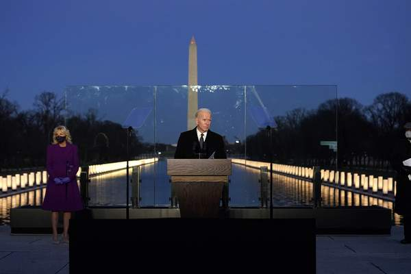 Associated Press President-elect Joe Biden speaks during Tuesday evening's COVID-19 memorial, with lights placed around the Lincoln Memorial Reflecting Pool.
