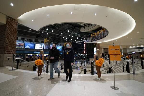 Fans arrive for an NBA basketball game between the Indiana Pacers and the Dallas Mavericks, Wednesday, Jan. 20, 2021, in Indianapolis. (AP Photo/Darron Cummings)