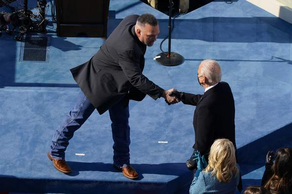 Country singer Garth Brooks shakes hands with President Joe Biden during the 59th Presidential Inauguration at the U.S. Capitol in Washington, Wednesday, Jan. 20, 2021. (AP Photo/Susan Walsh, Pool)