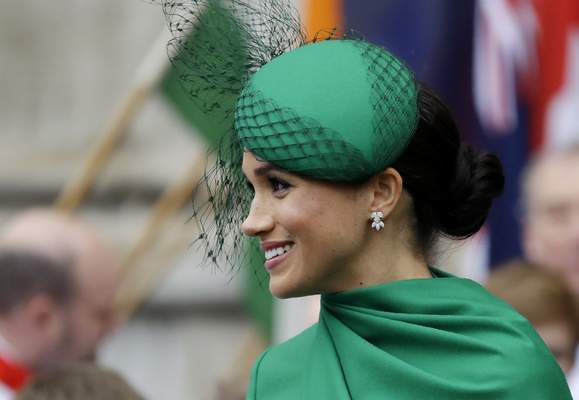 FILE - In this Monday, March 9, 2020 file photo, Britain's Meghan, the Duchess of Sussex leaves after attending the annual Commonwealth Day service at Westminster Abbey in London. (AP Photo/Kirsty Wigglesworth, File)