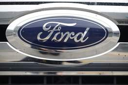 Ford Results FILE - In this Oct. 20, 2019, file photograph, the company logo shines off the grille of an unsold 2019 F-250 pickup truck at a Ford dealership in Littleton, Colo. Ford Motor Co. posted a stronger-than-expected third-quarter net profit, the company announced Wednesday, Oct. 28, 2020, as demand for cars and trucks recovered from coronavirus shutdowns and the company sold more high-margin trucks. (AP Photo/David Zalubowski, File) (David Zalubowski STF)