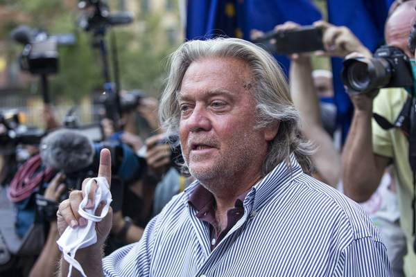 FILE - In this Aug. 20, 2020, file photo, President Donald Trump's former chief strategist, Steve Bannon, speaks with reporters in New York after pleading not guilty to charges that he ripped off donors to an online fundraising scheme to build a southern border wall. (AP Photo/Eduardo Munoz Alvarez, File)