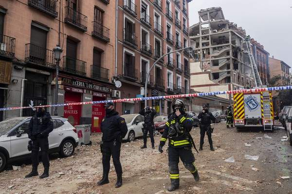 Police officers cordon off Toledo Street following an explosion in downtown Madrid, Spain, Wednesday, Jan. 20, 2021. (AP Photo/Bernat Armangue)