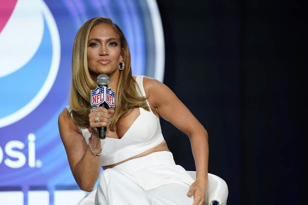FILE - In this Jan. 30, 2020 file photo, NFL Super Bowl 54 football game halftime performer Jennifer Lopez answers questions at a news conference in Miami. (AP Photo/David J. Phillip)