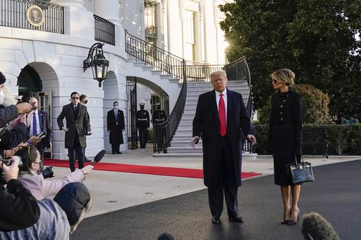 Trump President Donald Trump and first lady Melania Trump stop to talk with the media as they walk to board Marine One on the South Lawn of the White House, Wednesday, Jan. 20, 2021, in Washington. Trump is en route to his Mar-a-Lago Florida Resort. (AP Photo/Alex Brandon) (Alex Brandon