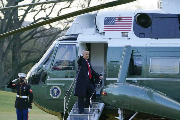 President Donald Trump gestures as he boards Marine One on the South Lawn of the White House, Wednesday, Jan. 20, 2021, in Washington. (AP Photo/Alex Brandon)