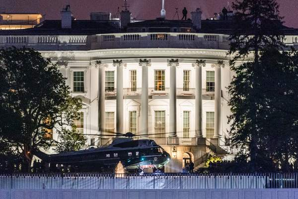 Marine One carrying President Donald Trump lands on the South Lawn at the White House, Tuesday, Jan. 12, 2021, in Washington. (AP Photo/Manuel Balce Ceneta)