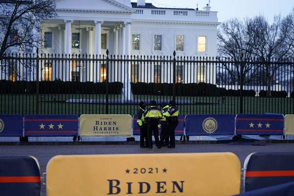 Security officers speak before Inauguration Day ceremonies outside the White House, Wednesday, Jan. 20, 2021, in Washington. (AP Photo/David J. Phillip)